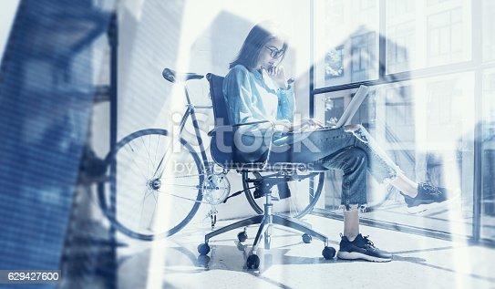 629421870 istock photo Beautiful girl using modern laptop in design studio.Concept of 629427600