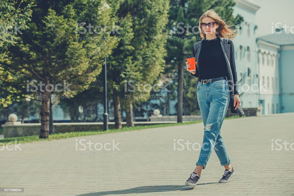 Beautiful girl walking on the pavement. stock photo