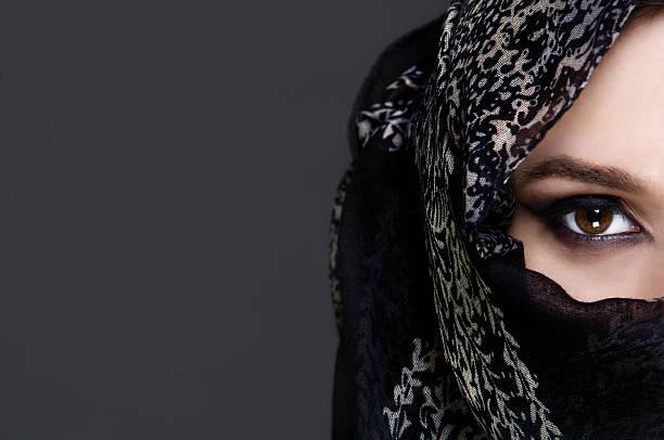 Beautiful girl wearing a niqab stock photo