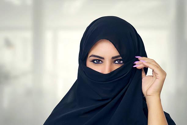 beautiful girl wearing burqa closeup - saudi woman stock photos and pictures