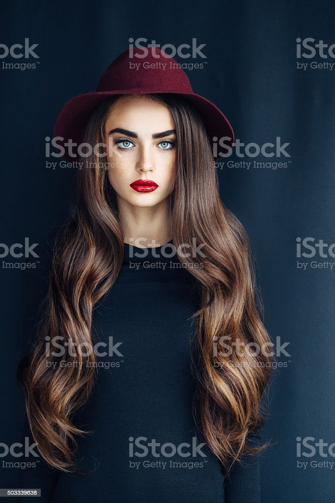 Beautiful girl wearing hat stock photo