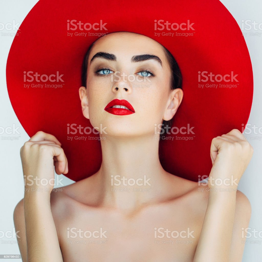 Beautiful girl wearing red hat stock photo