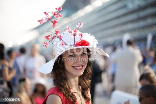 During the Dubai World Cup, this girl is wearing a beautiful Sakura inspired hat.