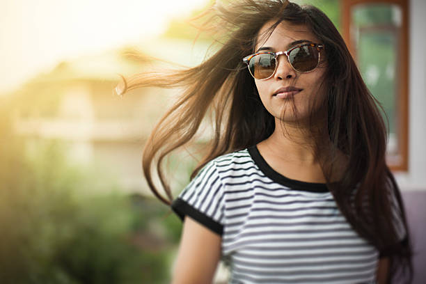 beautiful girl wearing sunglasses enjoying fresh air in balcony. - fille 16 ans photos et images de collection