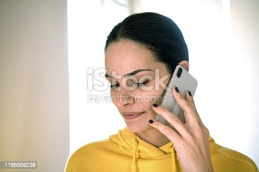 A beautiful girl who talking on the phone. Woman talking on cell phone.