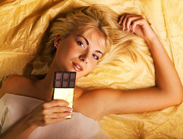 Beautiful girl with a chocolate stock photo