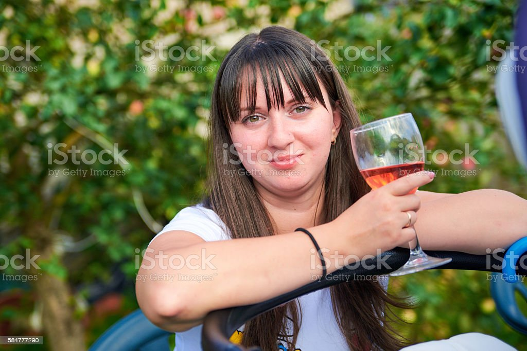 Beautiful girl with a glass of wine stock photo