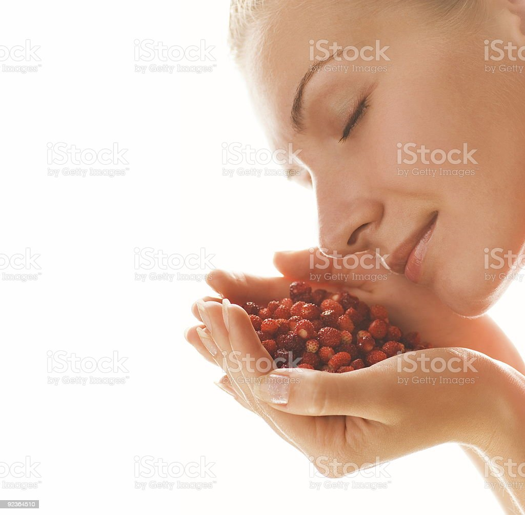 Beautiful girl with a handful of strawberries royalty-free stock photo