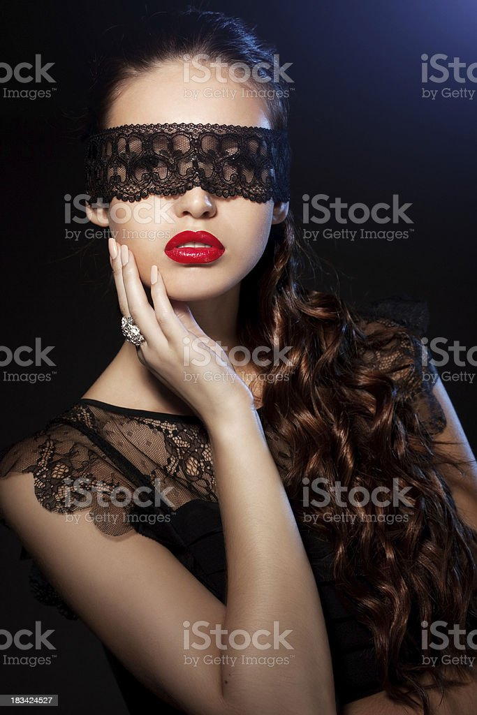beautiful girl with a lace fabric strip on the face royalty-free stock photo