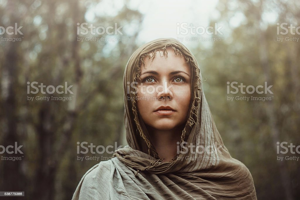 Beautiful girl with a scarf on her head stock photo