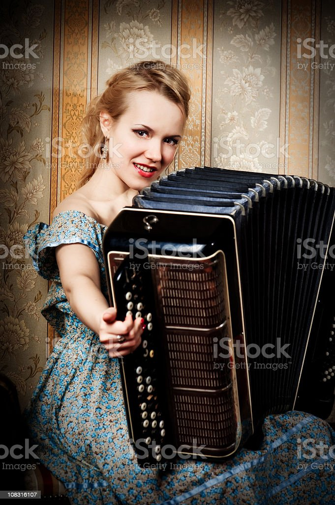 Beautiful girl with accardion royalty-free stock photo