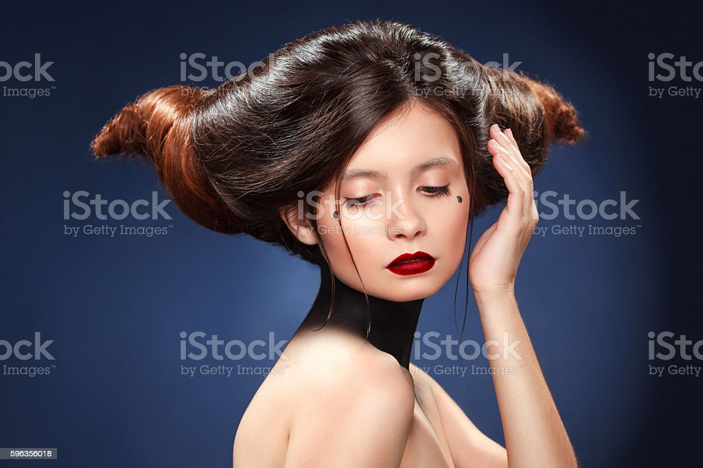 Beautiful girl with amazing hairstyle. Advertisment print for hairdressers. royalty-free stock photo