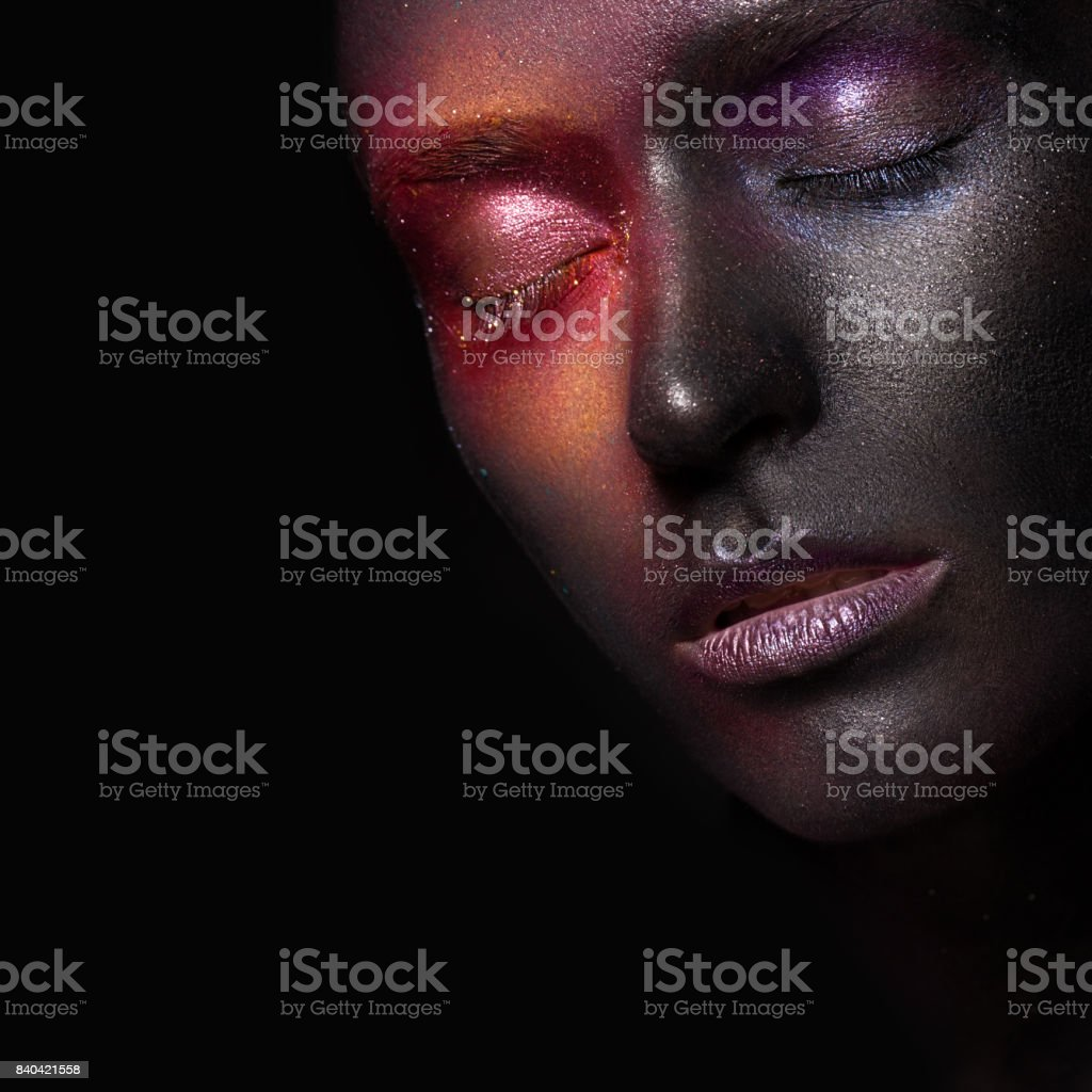 Beautiful girl with art space makeup on her face and body. Glitter Face. stock photo