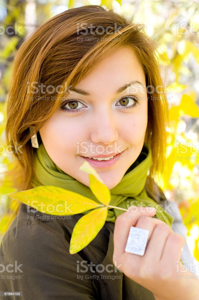 beautiful girl with autumn leaf royalty-free stock photo