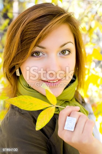 Beautiful Girl With Autumn Leaf Stock Photo & More Pictures of Adult