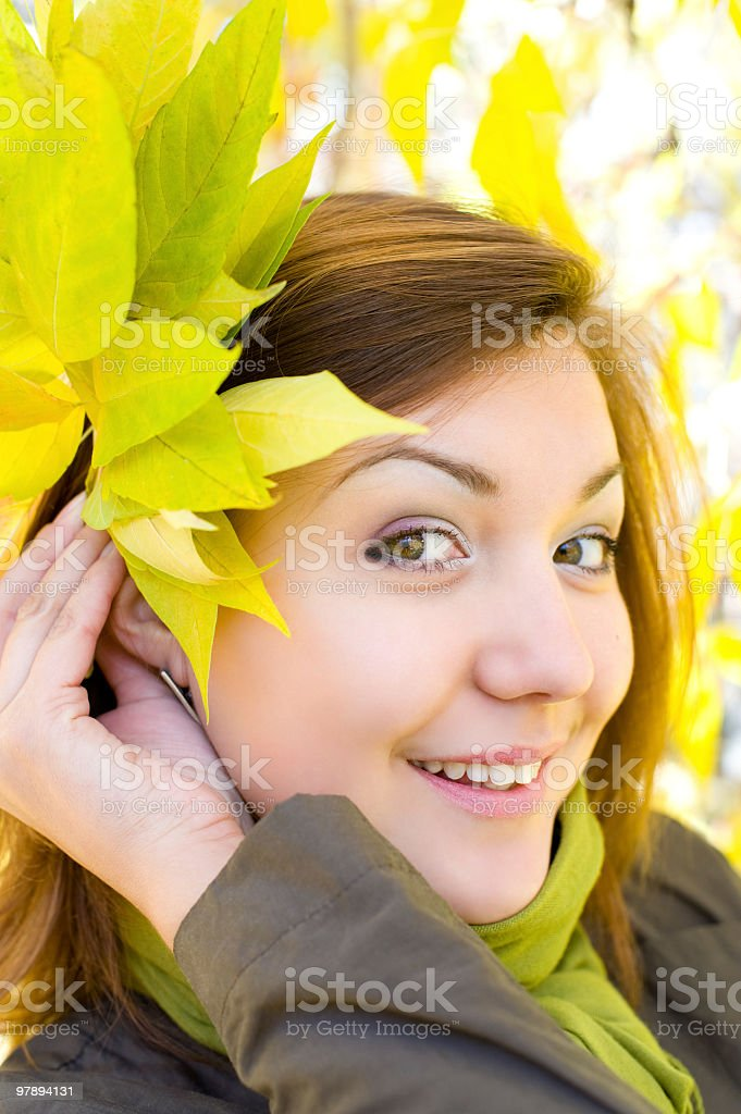 beautiful girl with autumn leaves royalty-free stock photo