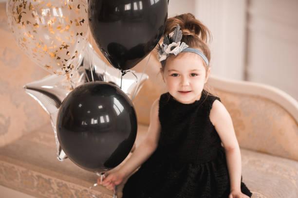 beautiful girl with balloons closeup - festliche babymode junge stock-fotos und bilder