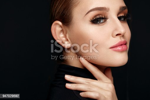 istock Beautiful Girl With Beauty Face, Makeup And Long Black Eyelashes 947029592