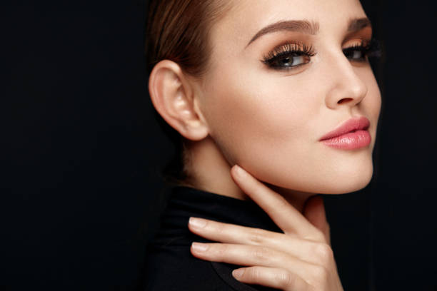 beautiful girl with beauty face, makeup and long black eyelashes - human lips stock pictures, royalty-free photos & images
