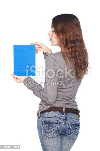istock Beautiful girl with blank blue banner. 180810734