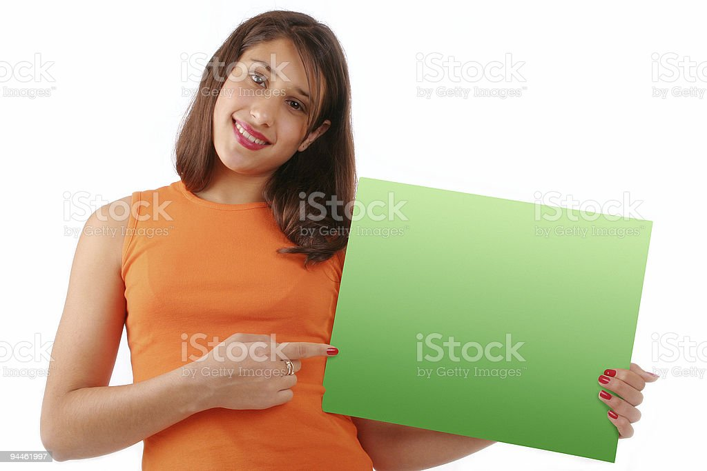 Beautiful girl with blank green sign royalty-free stock photo