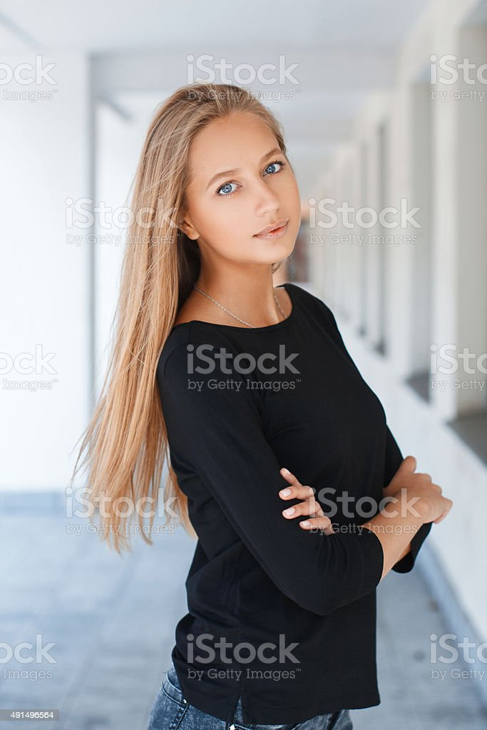 Beautiful girl with blue eyes in black t-shirt stok fotoğrafı
