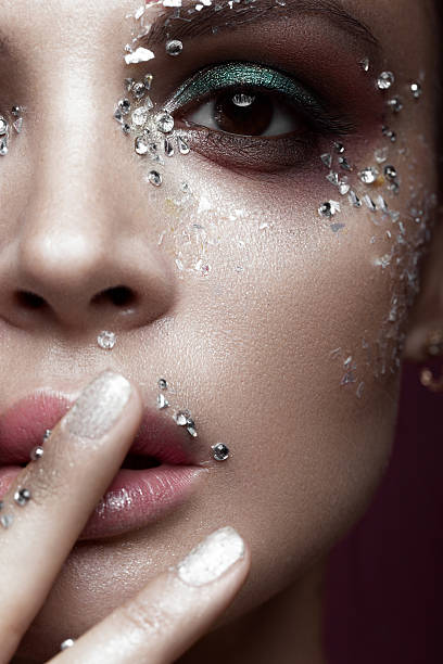 Beautiful girl with bright color makeup and crystals on the - foto de stock