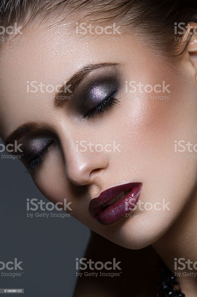 Beautiful girl with bright makeup stock photo