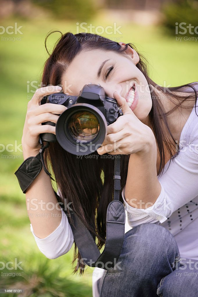 Beautiful girl with camera royalty-free stock photo