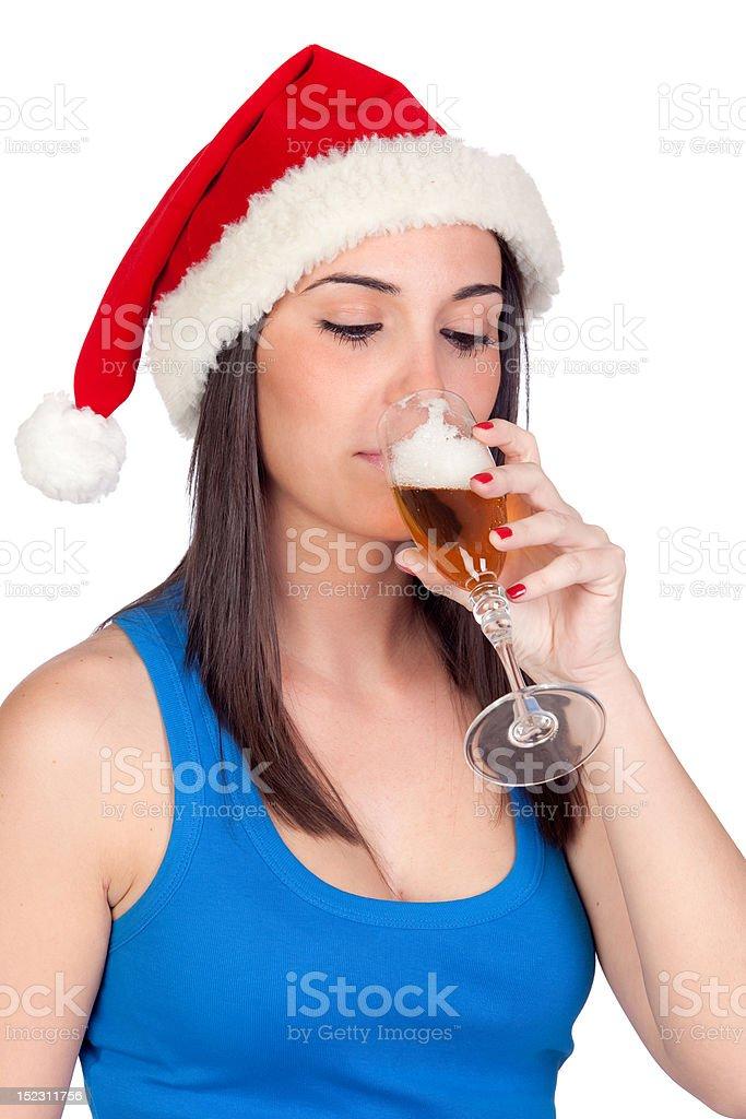 Beautiful girl with Christmas hat providing stock photo