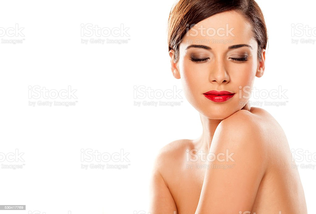 Beautiful girl with closed eyes on a white background stock photo