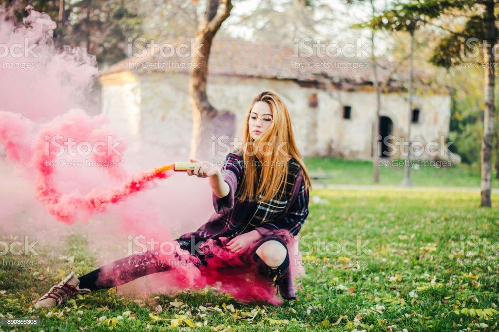Beautiful Girl With Colored Smoke Bomb Stock Photo