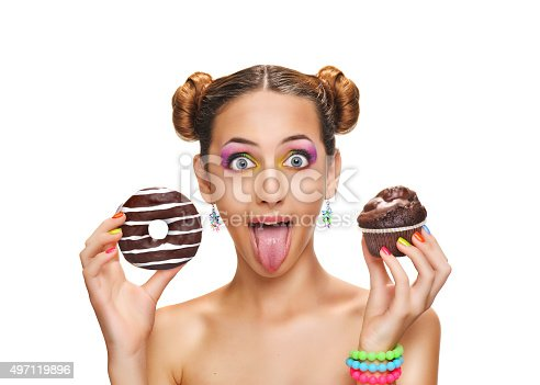 692840848istockphoto Beautiful girl with colorful donut and muffin . 497119896