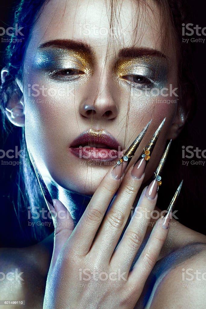 Beautiful girl with creative golden and silver glitter make-up Lizenzfreies stock-foto