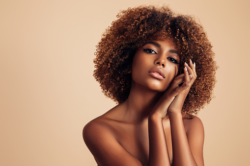Beautiful girl with curly hairstyle