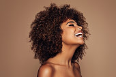 istock Beautiful girl with curly hairstyle 1283403399