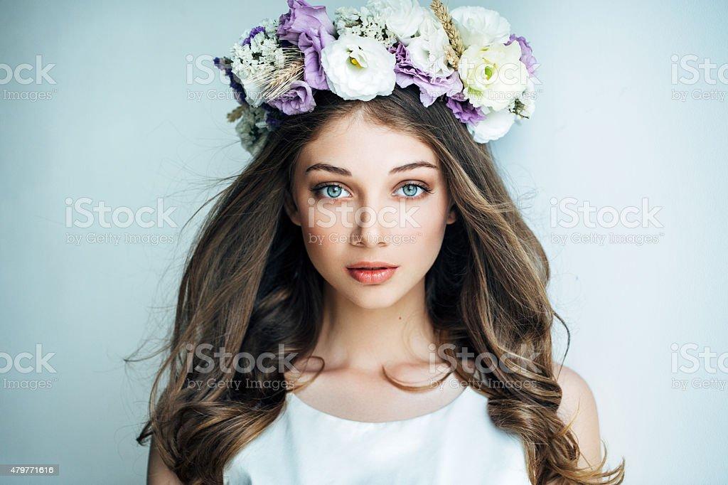 Beautiful girl with flower wreath stock photo