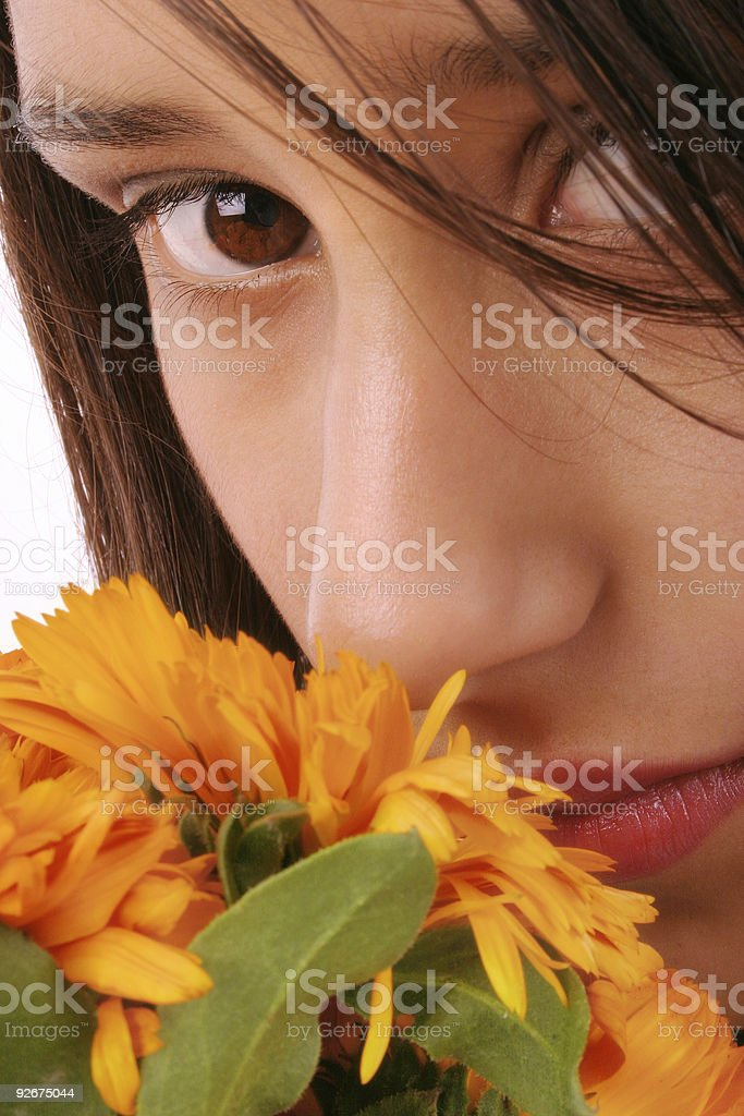 Beautiful girl with flowers 2 stock photo