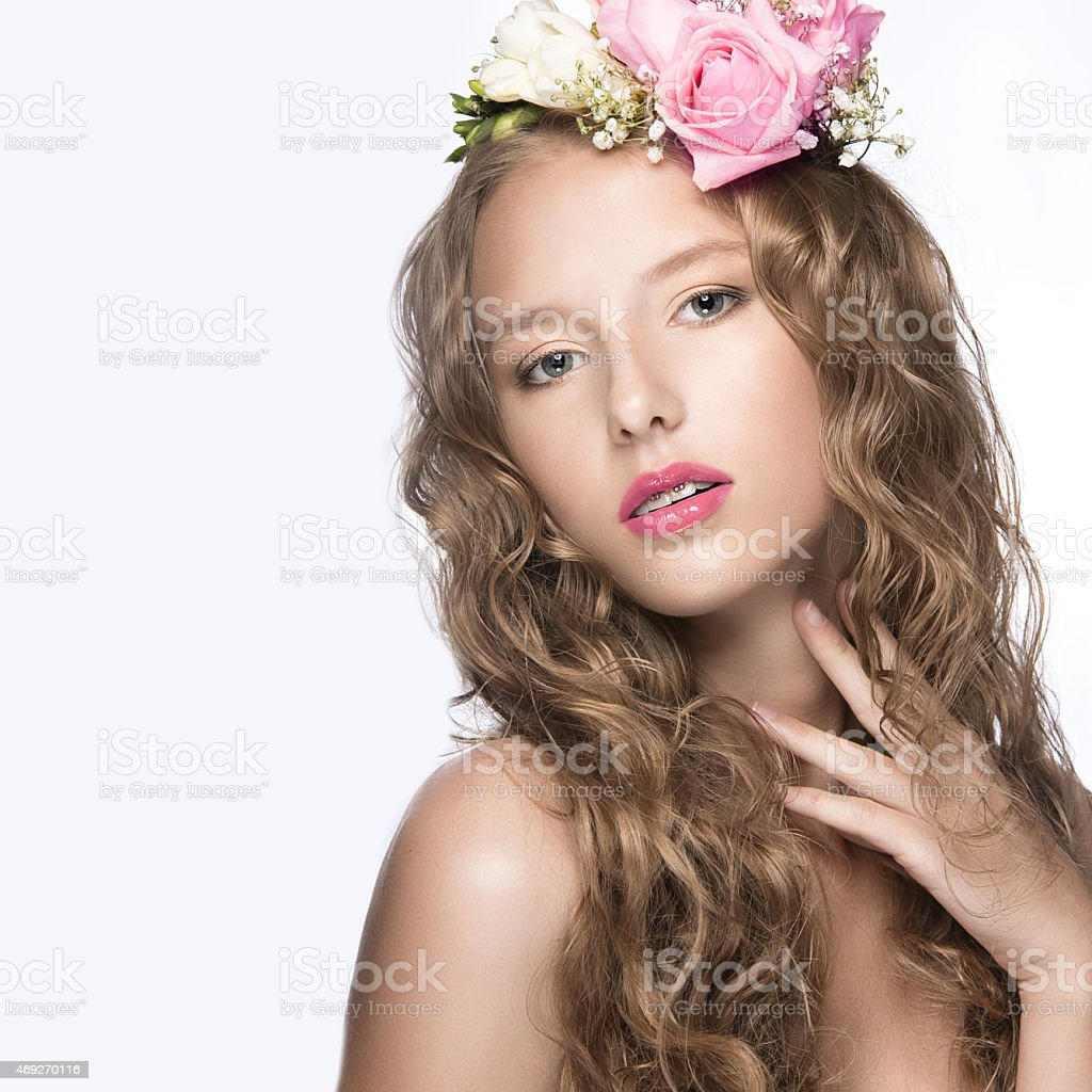 Beautiful girl with flowers in her hair and pink makeup stock photo beautiful girl with flowers in her hair and pink makeup royalty free stock photo izmirmasajfo