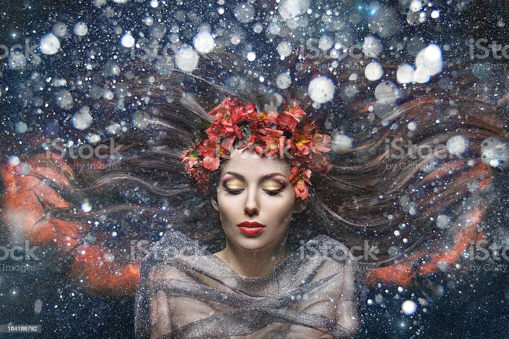 beautiful girl with flowers in her hair royalty-free stock photo