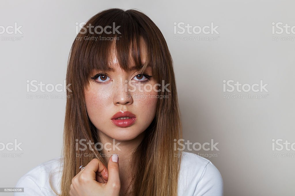 Beautiful girl with freckles stock photo