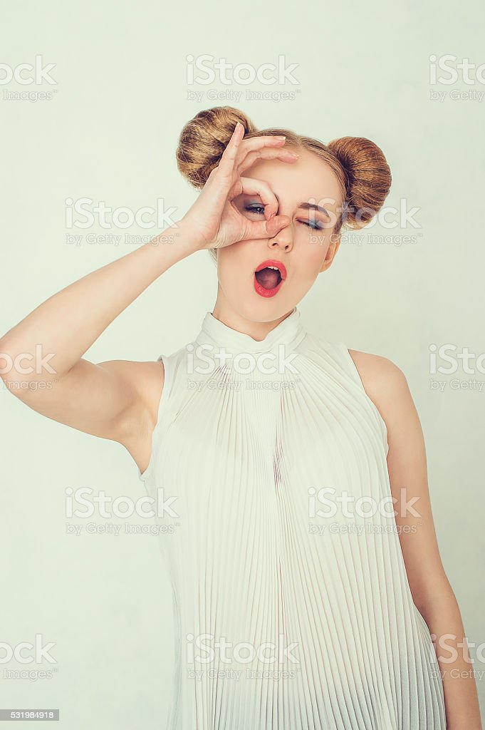 Beautiful girl with funny hairstyle. stock photo