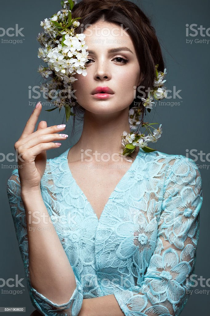 Beautiful girl  with gentle romantic make-up, pink lips and flowers stock photo