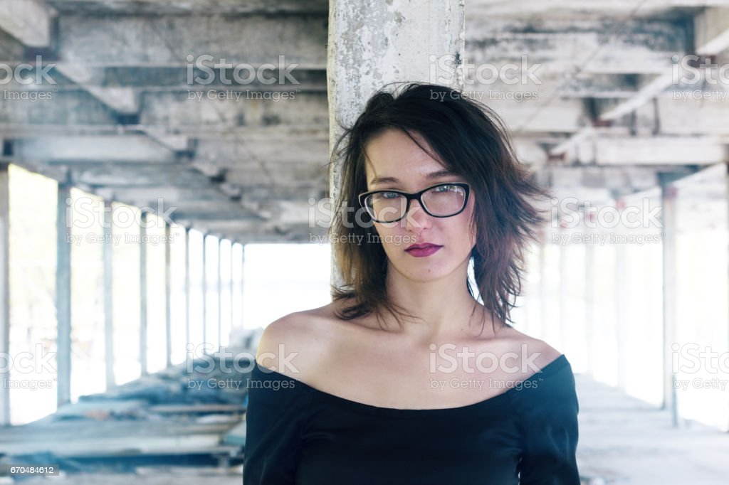 Beautiful girl with glasses on the ruins of the old city stock photo