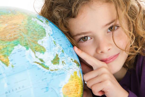 Beautiful girl with globe stock photo