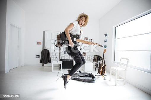 istock Beautiful girl with guitar 855638056