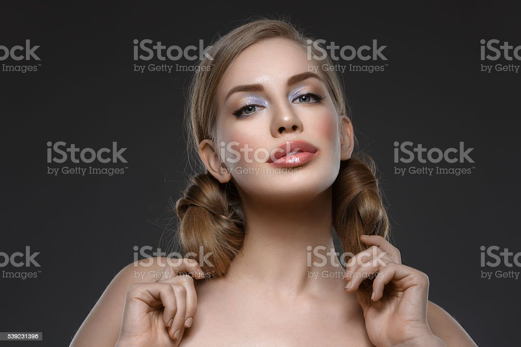 Beautiful girl with hair nods royalty-free stock photo