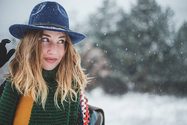 Beautiful girl with hat and backpack on winter day - Photo