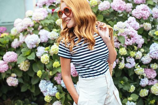 Beautiful girl with Hydrangea flowers