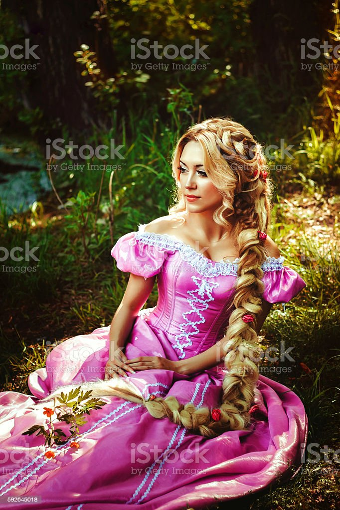 Beautiful girl with long hair braided stock photo